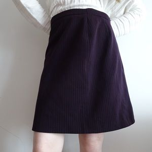 PURPLE SKIRT WITH VERTICAL STRIPES